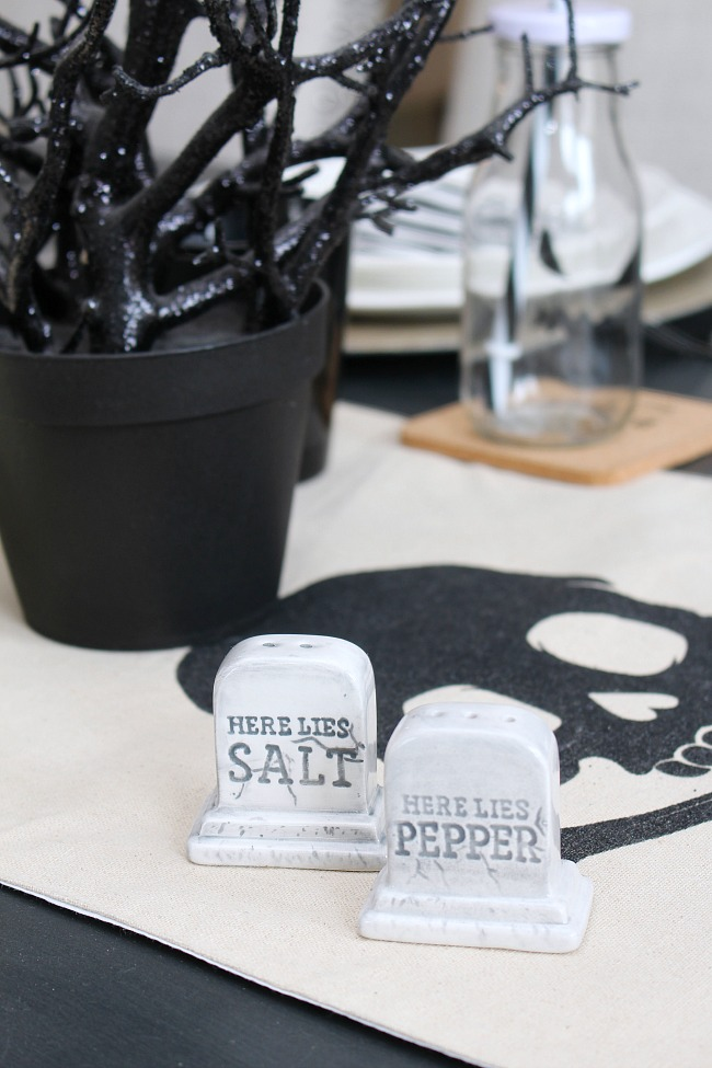 "Black and white Halloween decor ideas with ""Here Lies Salt"" and ""Here Lies Pepper"" salt and pepper shakers."