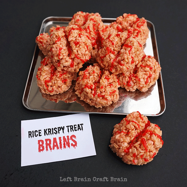 Halloween Rice Krispie treat brains using red gel and Rice Krispie treats shaped into a brain.