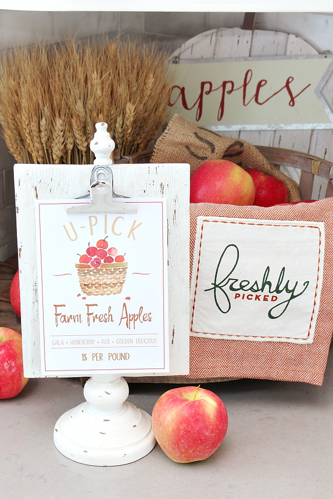 Farm Fresh Apples free fall printable on a clipboard frame with basket of apples.
