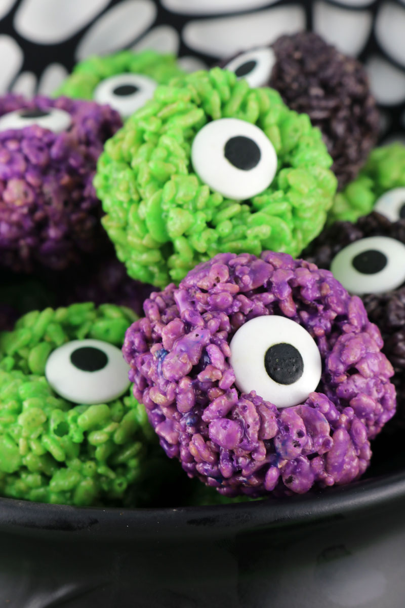 Monster eyes Rice Krispie treats for Halloween. Round rice krispie treats with a candy eye in the middle.
