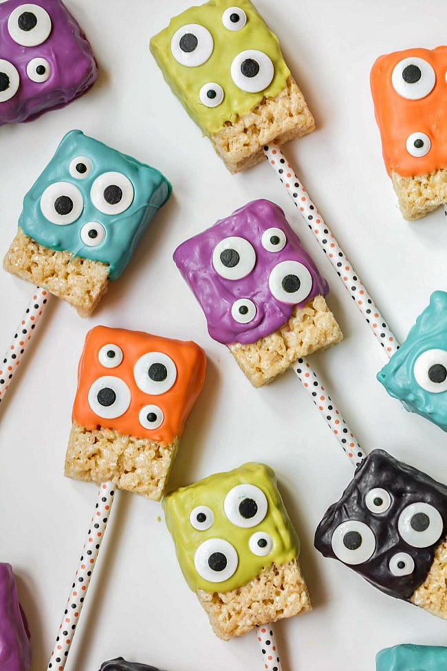 Monster Rice Krispie treats with colored chocolate and candy eyes.