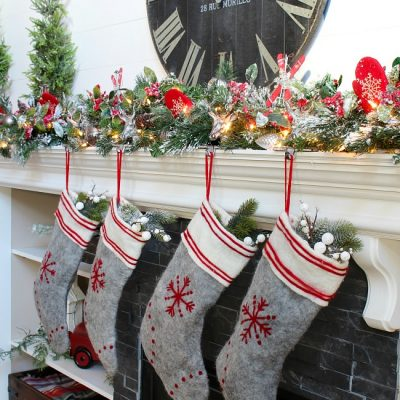Christmas mantel with flocked garland, felted wool stockings, and traditional Christmas colors.