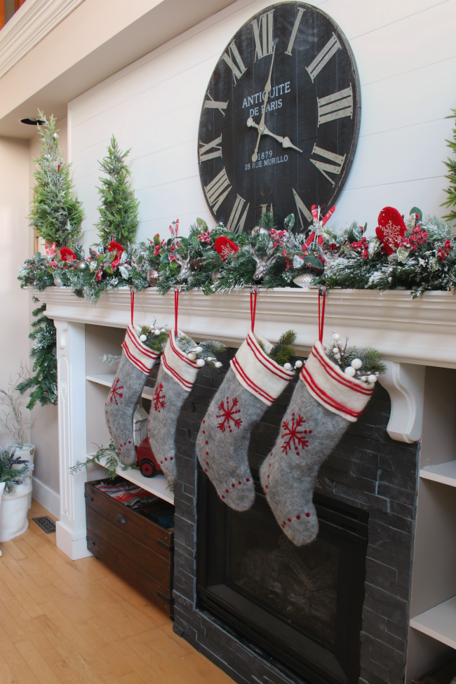 Christmas mantel with red and grey felted wool stockings.
