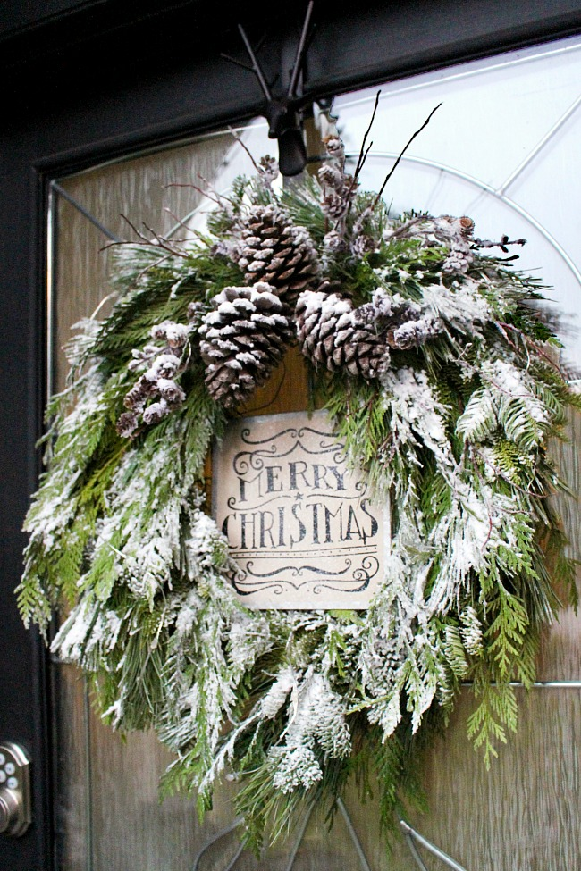 Beautiful DIY Christmas Christmas wreath with fresh greenery. Flocked for a pretty wintery look.