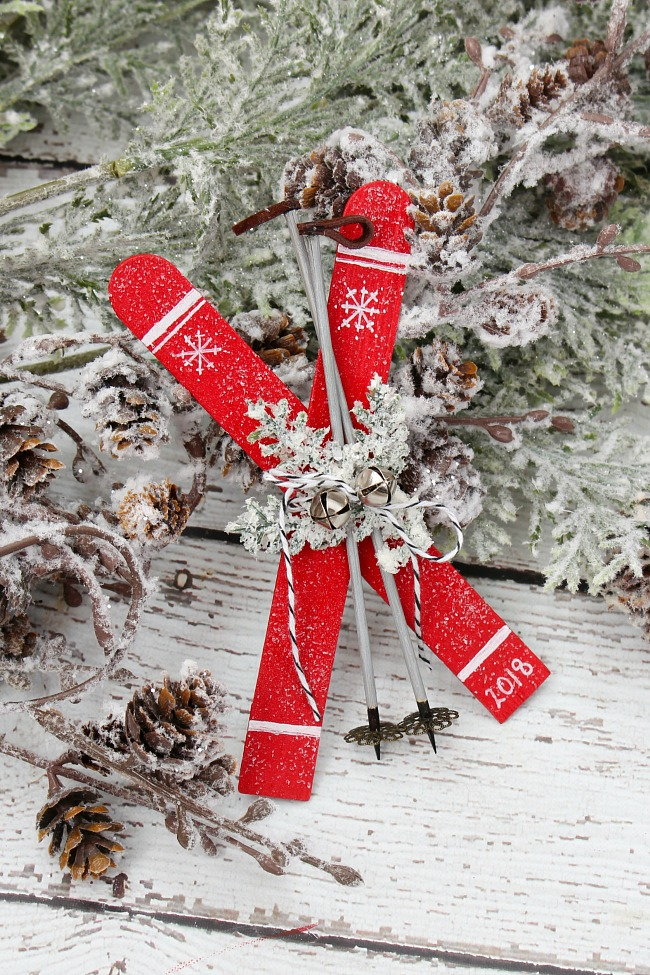Skis Christmas ornament made from popsicle sticks.