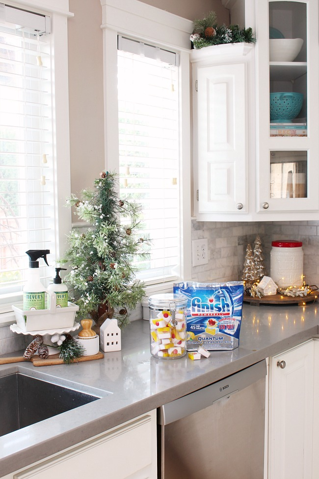 How to keep your home clean for the holidays. Christmas kitchen with dishwasher pods on quartz counters.