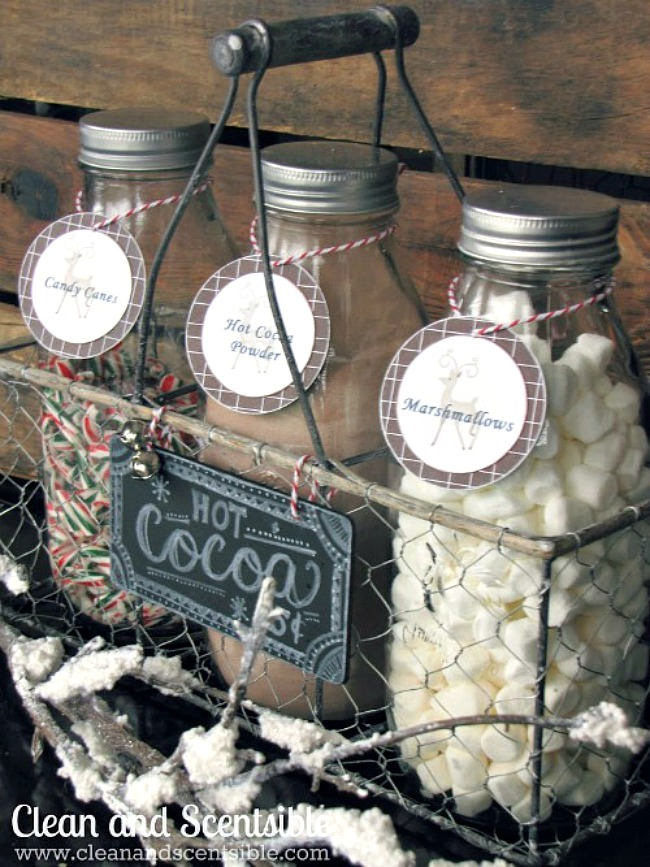 Quick and easy Christmas hot chocolate bar using milk bottles and a wire basket. Free printable hot chocolate bar labels included.