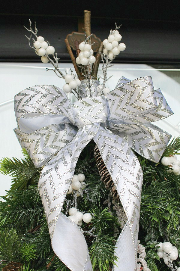 How to make a bow out of ribbon. Pretty bow made from ribbon on a swag wreath.