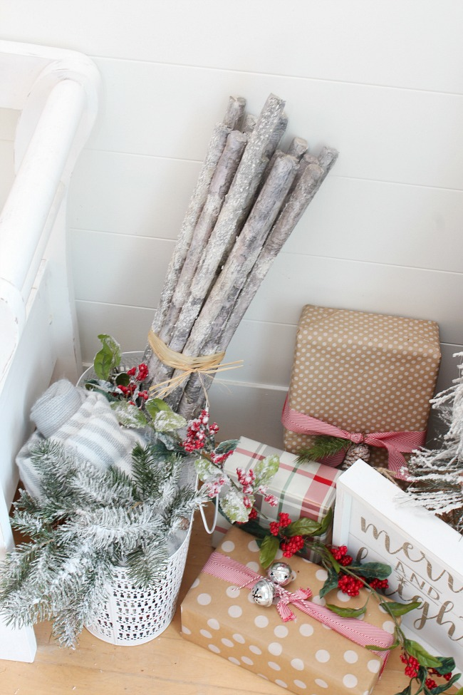 Christmas front entry way with faux wrapped presents and a warm and cozy feeling.