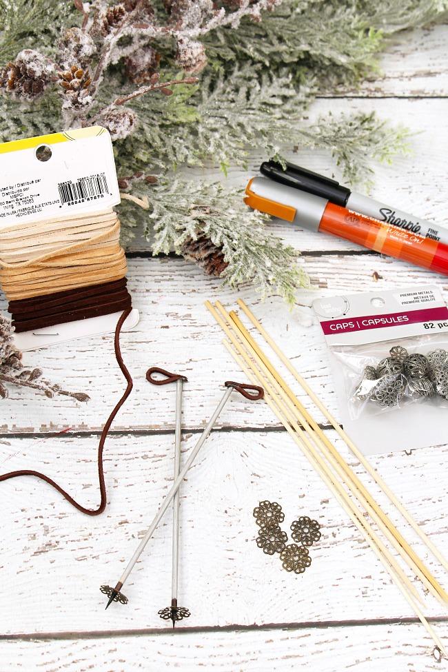 Step by step tutorial to make ski poles and popsicle stick skis Christmas ornament.