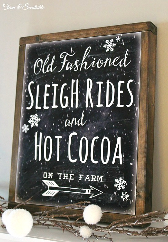 Old fashioned sleigh rides free Christmas printable on a DIY wood framed canvas.