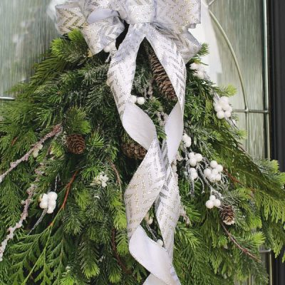 How to make a bow from ribbon. Pretty bow made from ribbon on a swag wreath.