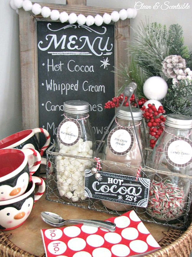 Christmas hot cocoa bar using milk bottles and a wire crate.