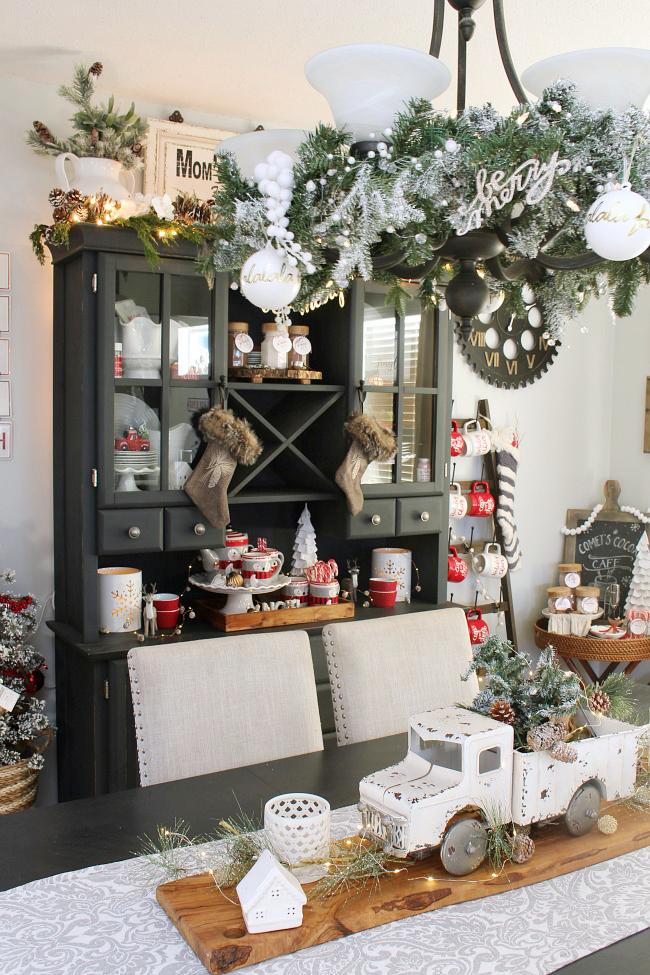 Christmas farmhouse dining room decorated with red, black and white.