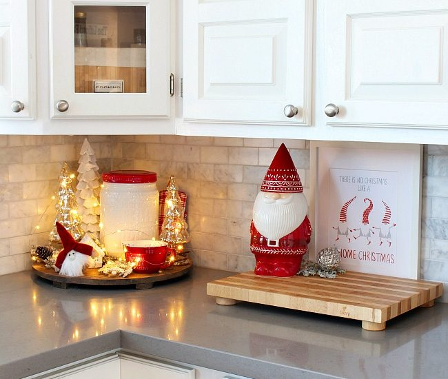 White kitchen with cute Christmas gnome cookie jar all decorated for Christmas in red and white.