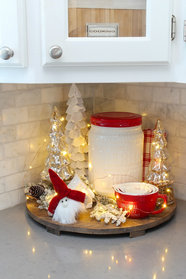 Red and white Christmas kitchen vignette on a wood tray with twinkle lights.