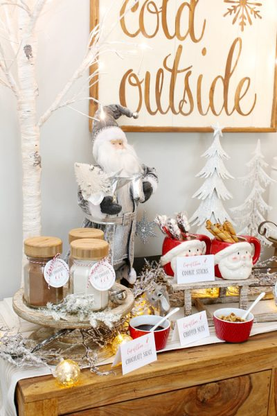 Cute Christmas hot chocolate bar on a side bar. Free printable hot chocolate bar labels included.