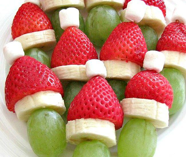 Grinch fruit kabobs using grapes, bananas and strawberries.