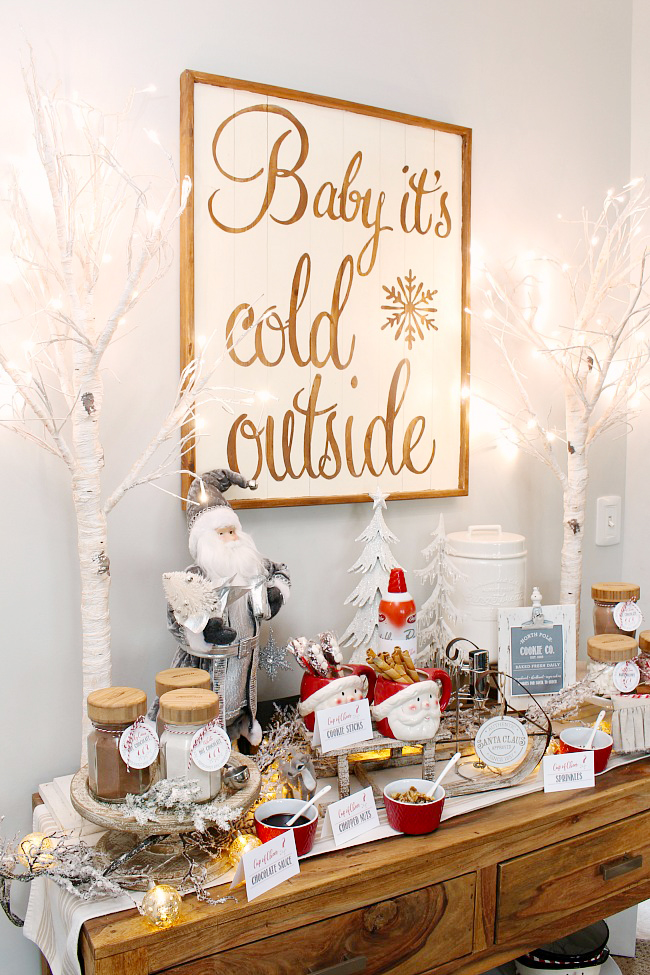 Pretty hot chocolate bar set up for Christmas on a side board.