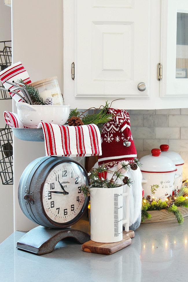White Christmas kitchen decorated with red and white with Christmas gnomes.