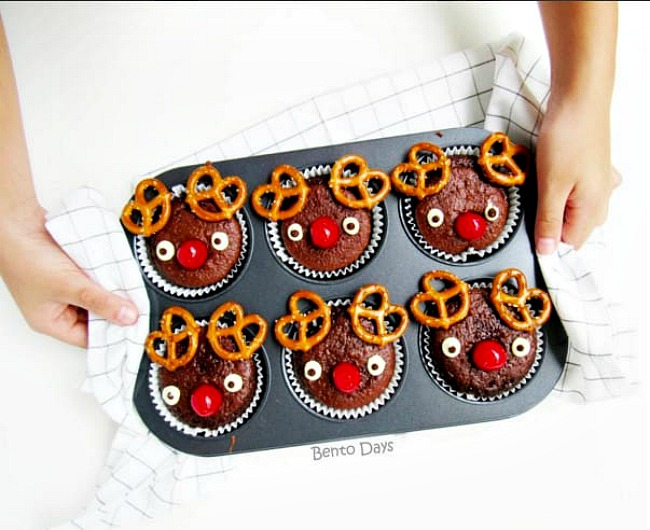 Rudolph muffins using bran muffins, pretzels, and candy eyes.