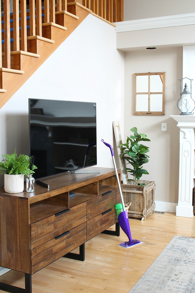 How to clean wood floors. Swiffer Wet Jet cleaning wood floors in a family room.