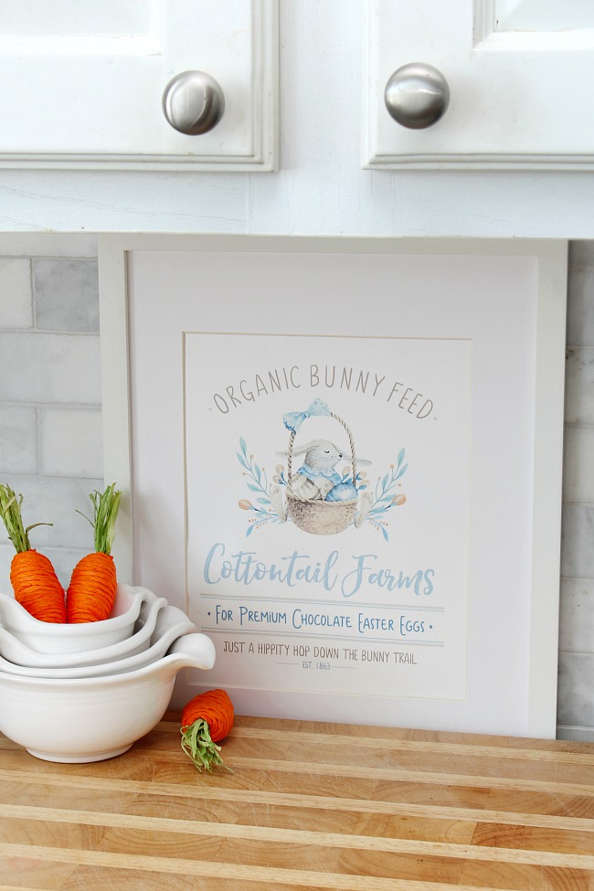 Cottontail Farms free Easter printable framed in a white frame and used for spring kitchen decor.
