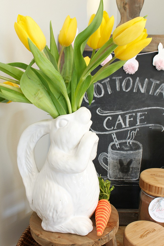 Adorable bunny vase with yellow tulips.  Part of a cute Easter hot chocolate bar.