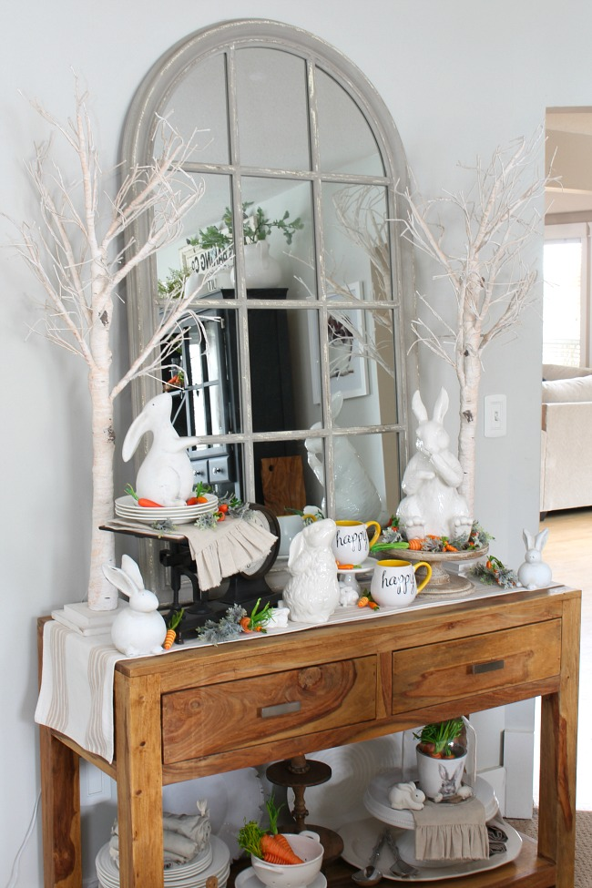Spring dining room with sideboard decorated with white ceramic bunnies.