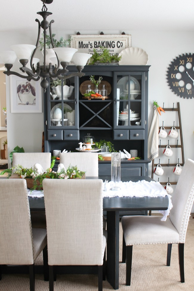 Farmhouse style dining room decorated for spring and Easter.