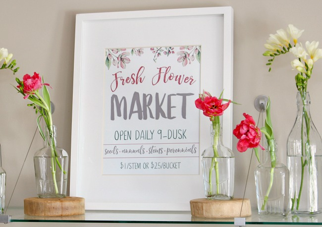 Beautiful Fresh Flower Market free spring printable displayed in a white frame with simple fresh flower vignette.