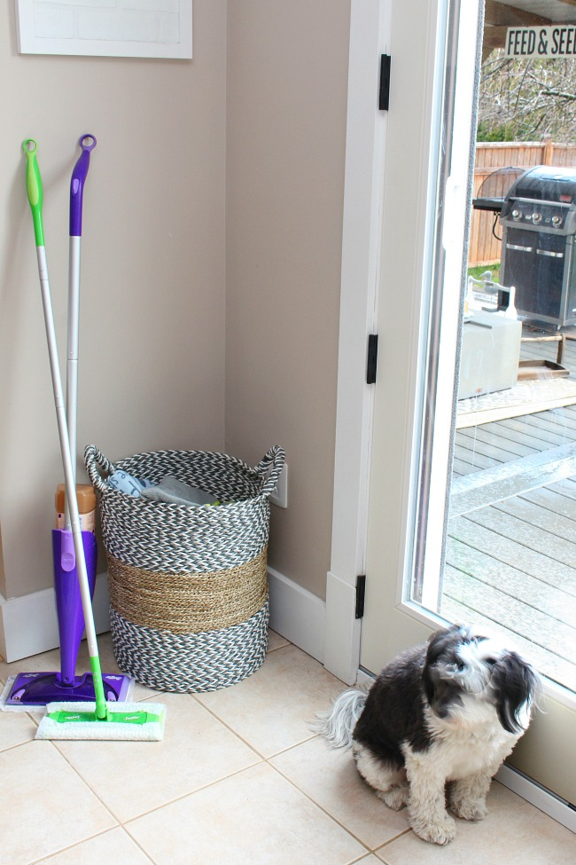 Entryway with Swiffer Sweeper and basket of towels to clean up after muddy paw prints.