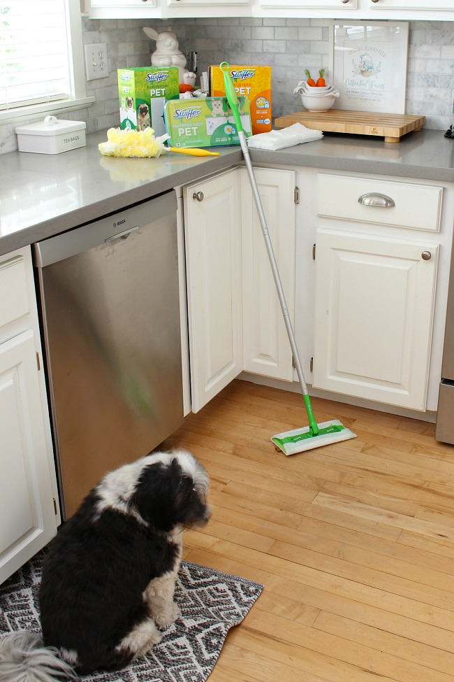 White kitchen with Swiffer pet cleaning products.