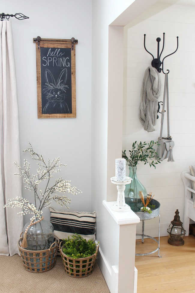 Farmhouse style Easter chalkboard in a spring dining room.