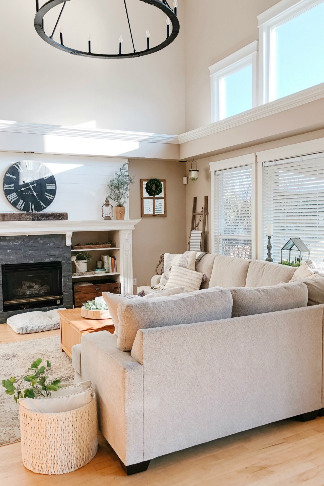 Bright and airy family room with large sectional.
