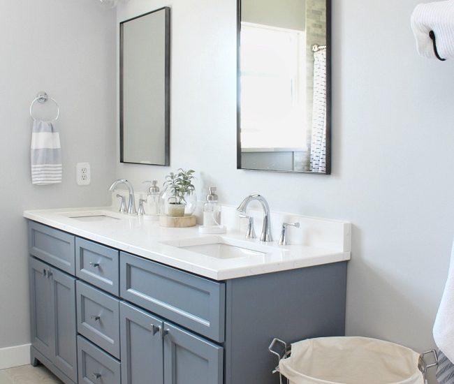 Coastal style bathroom with double vanity.