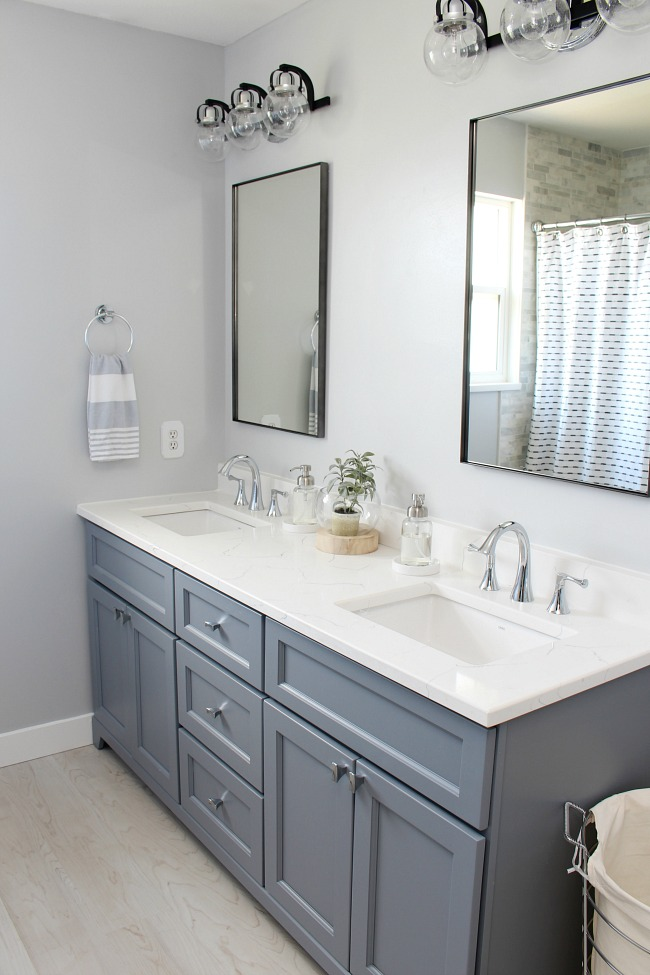 Grey double vanity with quartz countertops.