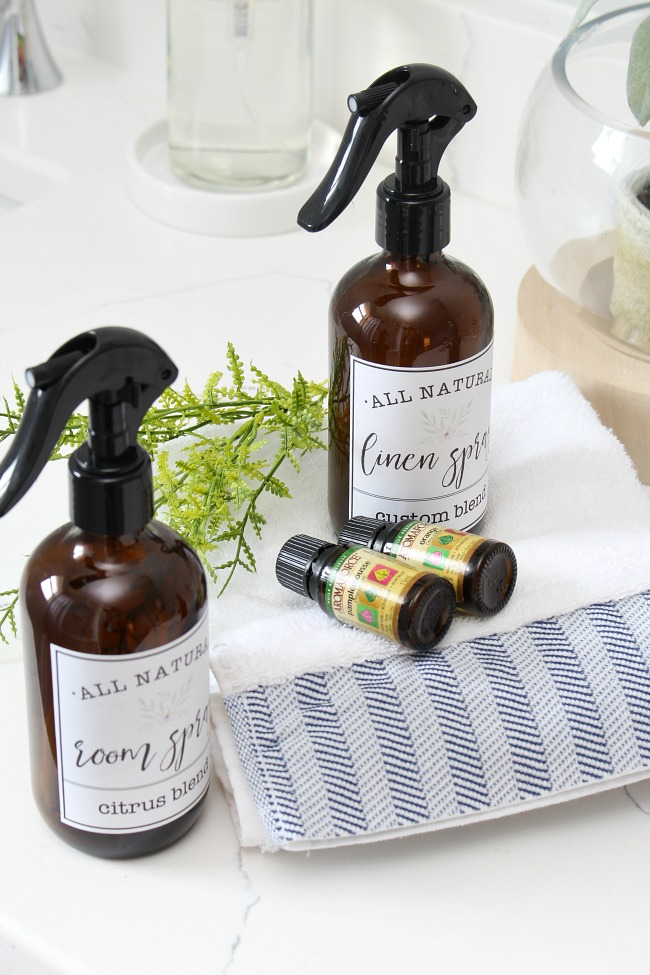 DIY room and linen sprays in cute amber spray bottles with free printable labels.