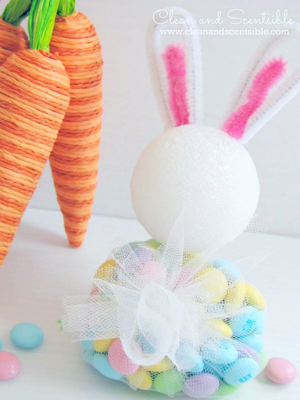 DIY Easter bunny treats using Easter colored M&Ms and some basic craft supplies. Cute tulle bunny tail in the back.
