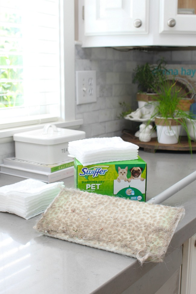 Swiffer Sweeper Pet pad with trapped dirt, debris and pet hair.