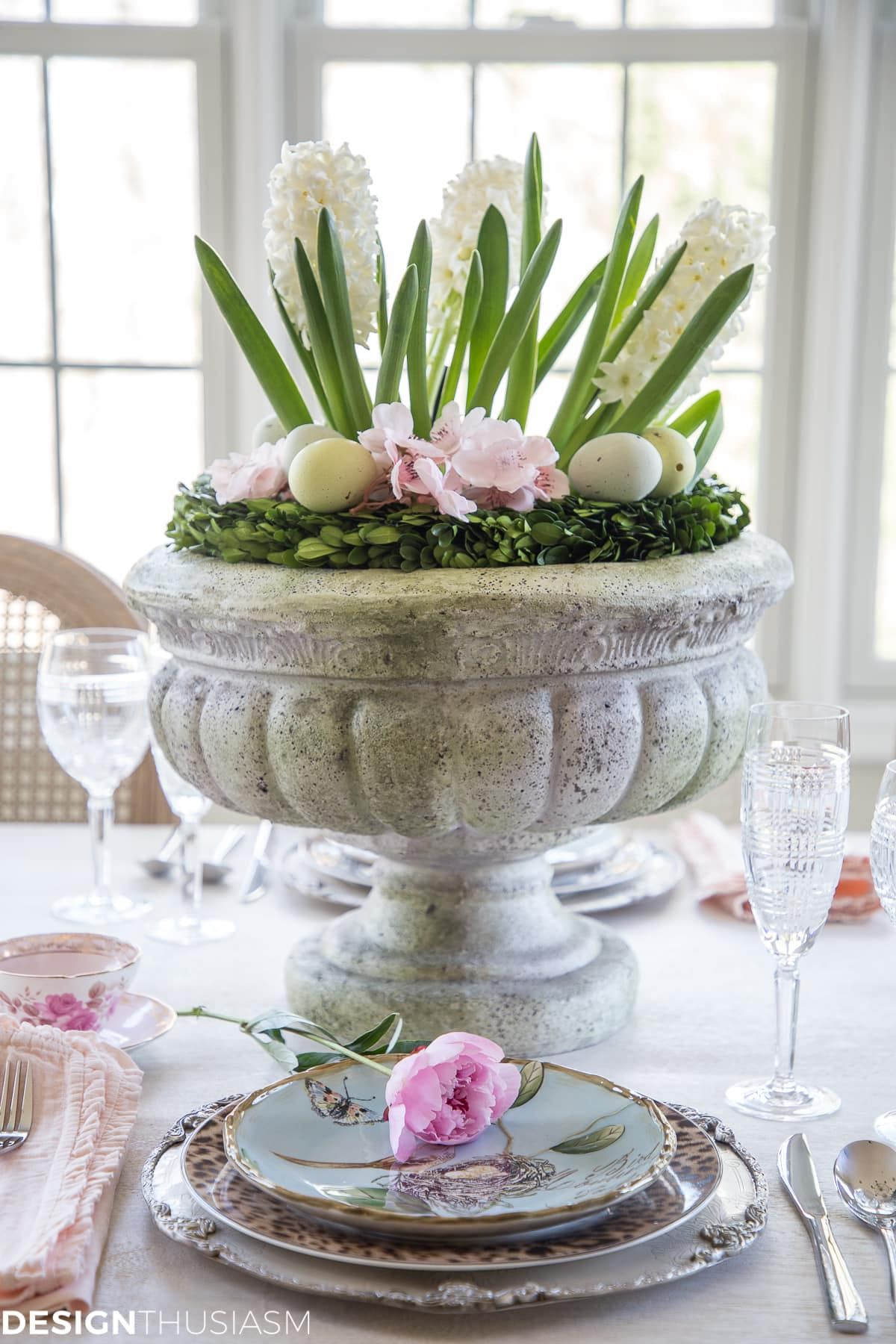 Beautiful spring flower centerpiece in a pedestal planter.