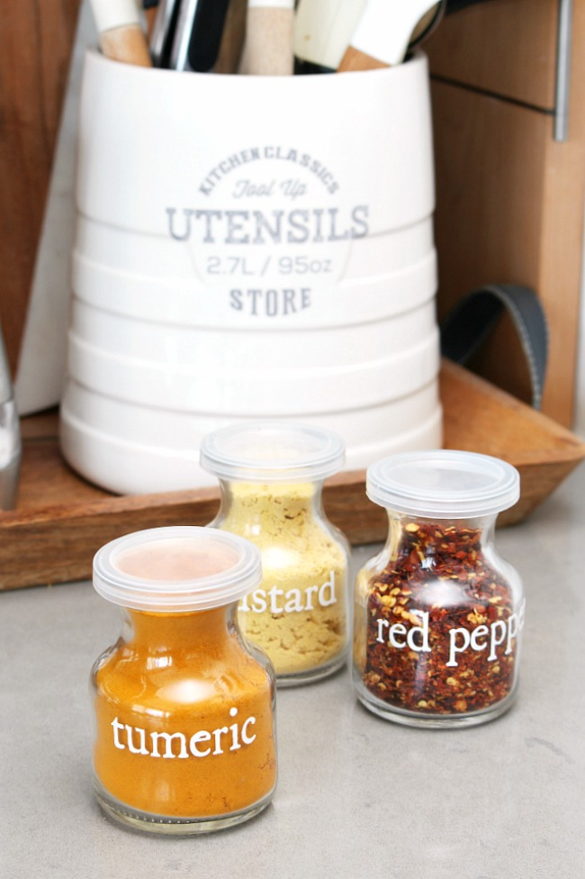 Cute glass jars with vinyl labels for spices.