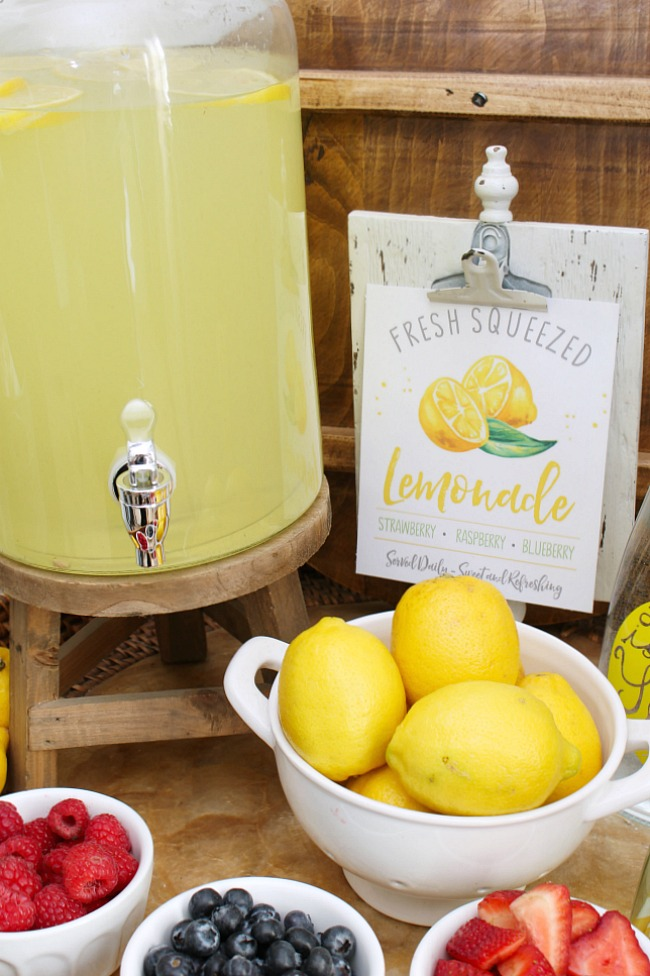 Simple lemonade bar with fresh fruit and free lemonade stand printables.