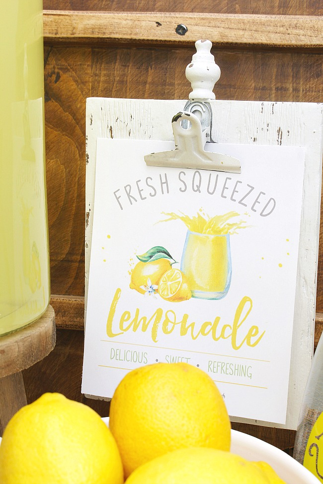 Fresh squeezed lemonade printable displayed in a cute lemonade bar.