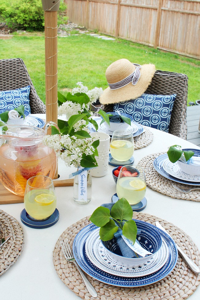 Beautiful summer tablescape with blue and white decor and free printable tags.