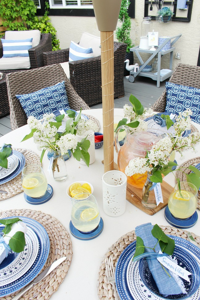 Simple summer entertaining idea. Summer tablescape using blues and whites with fresh flowers and greenery.