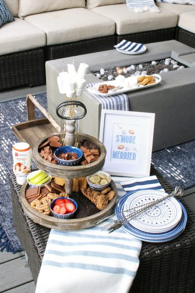 Cute s'mores bar display with tiered tray and free s'mores printables.