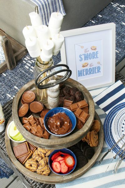 Cute DIY s'mores bar on a tiered tray.