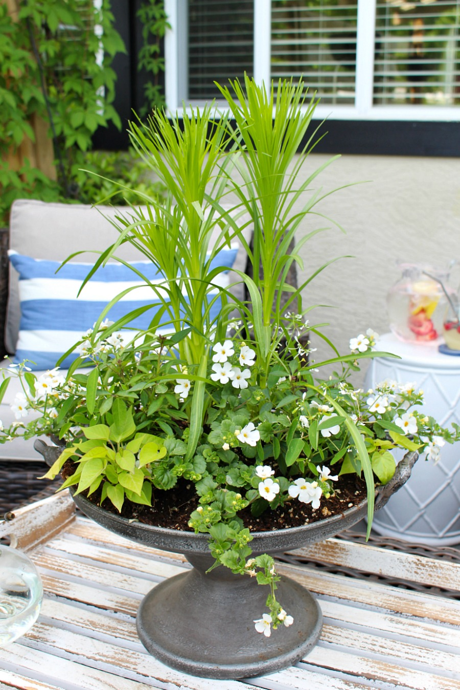 White and green summer planter on a summer patio.