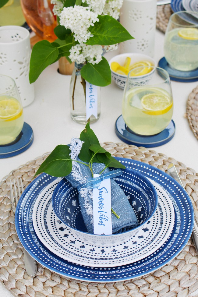 Pretty summer tablescape with navy, whites, and fresh greenery. Summer vibes free printable tags for the place settings or vases.